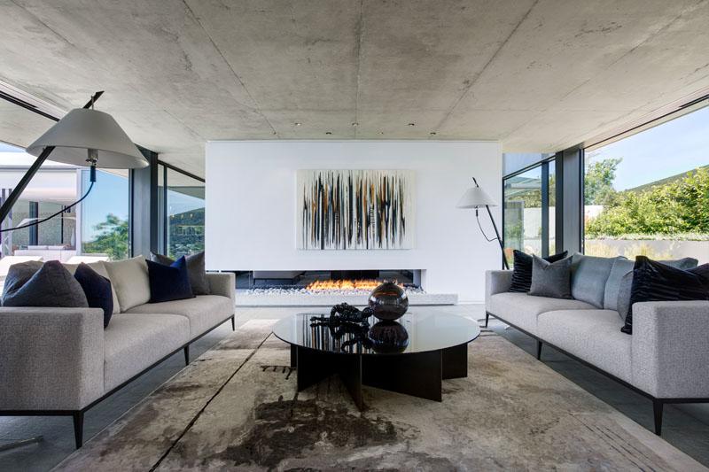 Этот бетонный дом был спроектирован с потрясающими видами с видом на город