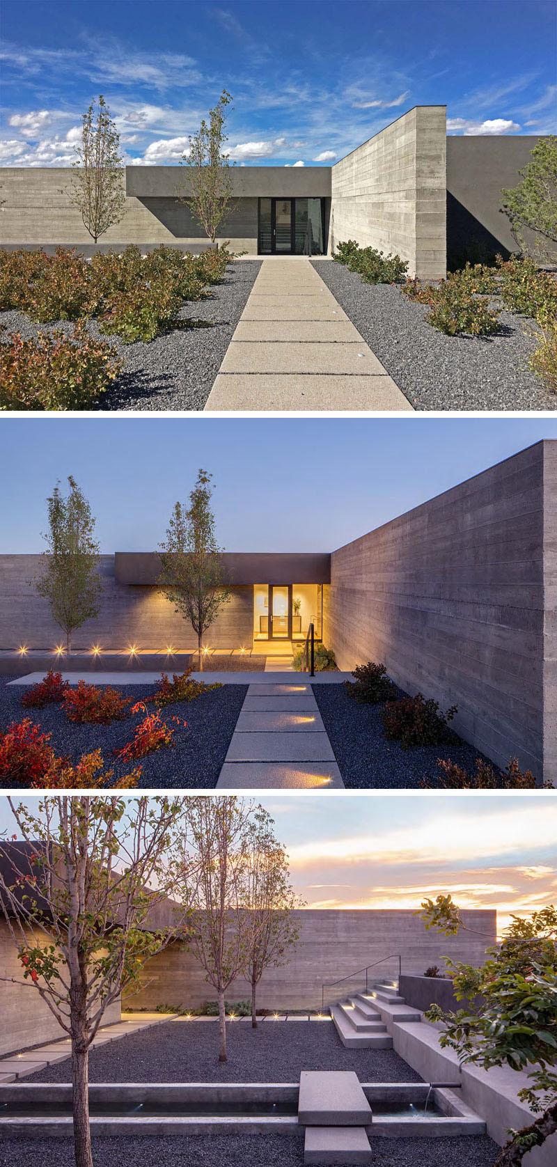 «Specht Architects» совсем недавно завершили этот современный дом в Санта-Фе, Нью-Мексико, который организован вокруг двух перпендикулярных бетонных стен, сформированных при помощи досок.